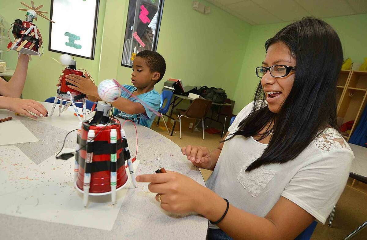 Hour Photo/Alex von Kleydorff Daniela Zurita watches as her Art Bot draws a design with others at Learning for Life summer program at SoNo Community Center