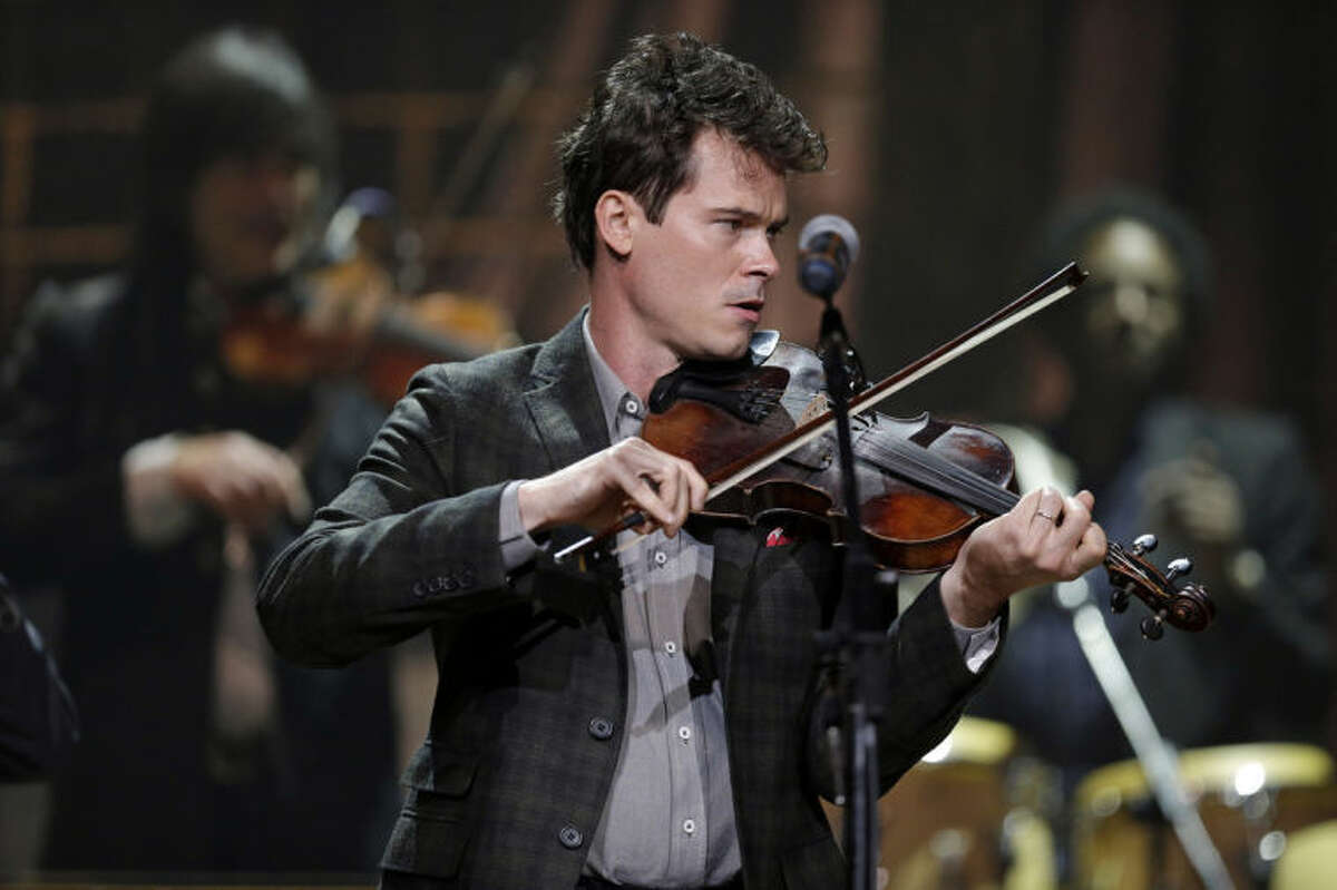 FILE - This Sept. 18, 2013 file photo shows Ketch Secor of The Old Crow Medicine Show performing during the Americana Music Honors and Awards Show in Nashville, Tenn. The band had their biggest hit of their career by adapting an unfinished Bob Dylan song into