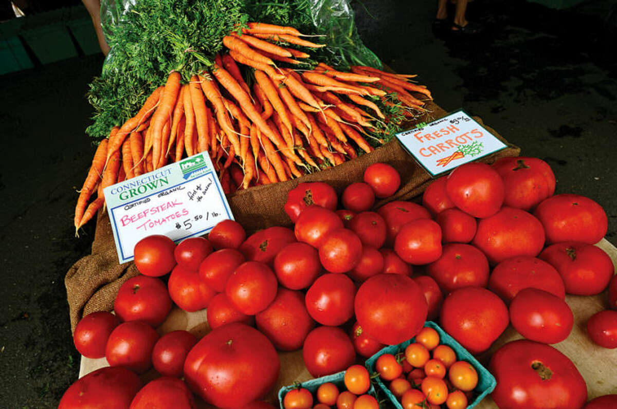 Hour photo / Erik Trautmann Fresh vegetables offered from Fort Hill farms at the annual Westport Farmers' Market Thursday morning.