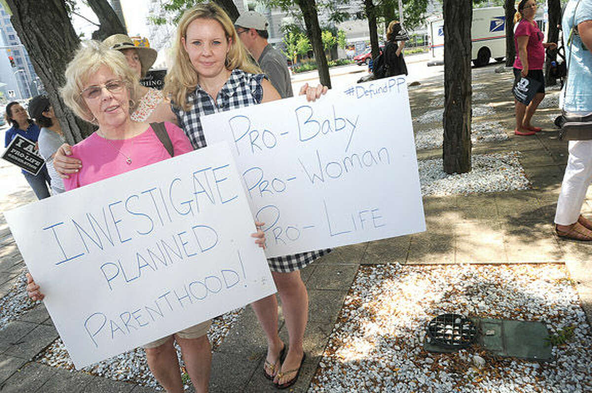 Becky Stenton and Erin Won at the rally to defund Planned Parenthood held at the Government Center in Stamford on Tuesday. Photo/Matthew Vinci