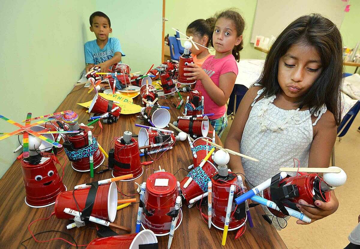 Hour Photo/Alex von Kleydorff Angie Aguilar picks an Art-Bot from the ones they made in the Learning for Life summer enrichment program at the Sono Community Center