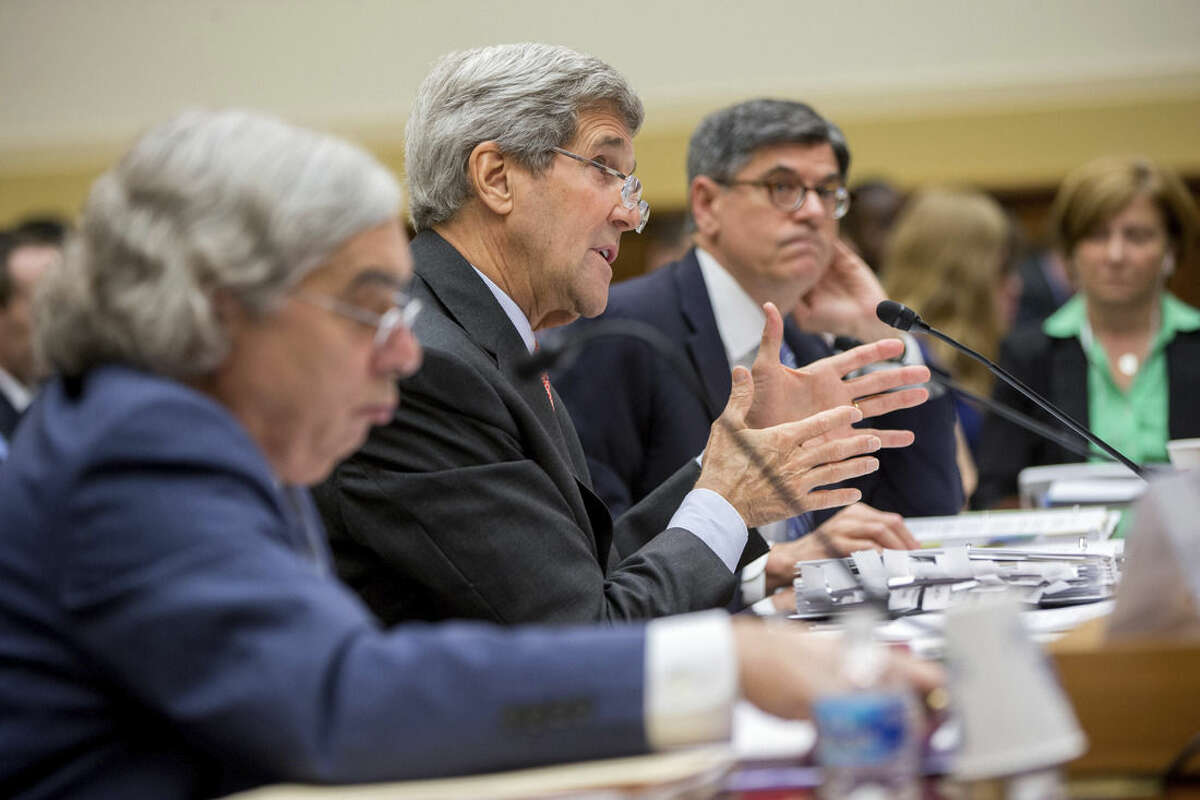 Secretary of State John Kerry, center, flanked by Treasury Secretary Jacob Lew, right, and Energy Secretary Ernest Moniz, testifies on Capitol Hill in Washington, Tuesday, July 28, 2015, before the House Foreign Affairs Committee hearing on the Iran Nuclear Agreement. Kerry pitched the administration's controversial nuclear deal with Iran to a skeptical House Foreign Affairs Committee on Tuesday, pushing back against the allegation it would ease crippling sanctions forever in exchange for temporary concessions on weapons development. (AP Photo/Andrew Harnik)