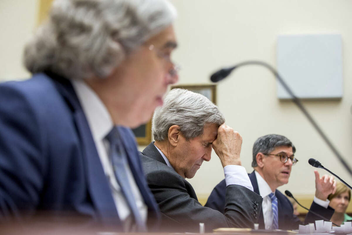 Secretary of State John Kerry, center, flanked by Treasury Secretary Jacob Lew, right, and Energy Secretary Ernest Moniz, left, pauses on Capitol Hill in Washington, Tuesday, July 28, 2015, as they testified before the House Foreign Affairs Committee hearing on the Iran Nuclear Agreement. (AP Photo/Andrew Harnik)