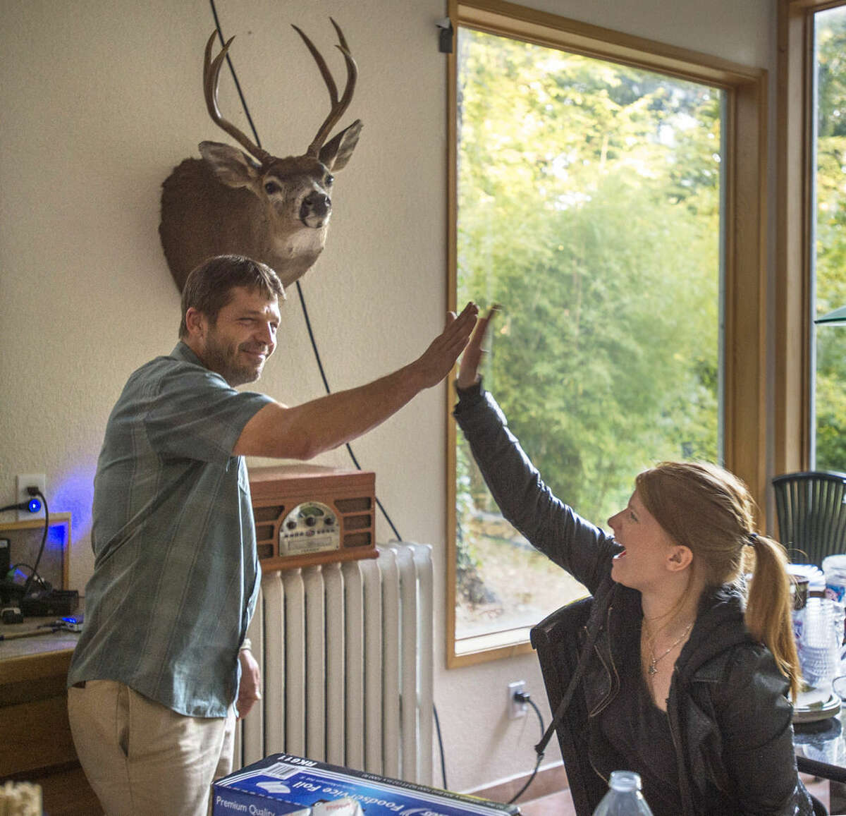 In a Tuesday, July 21, 2015 photo, actor Jason Stange high fives co-star Katie Hemming during filming for the movie