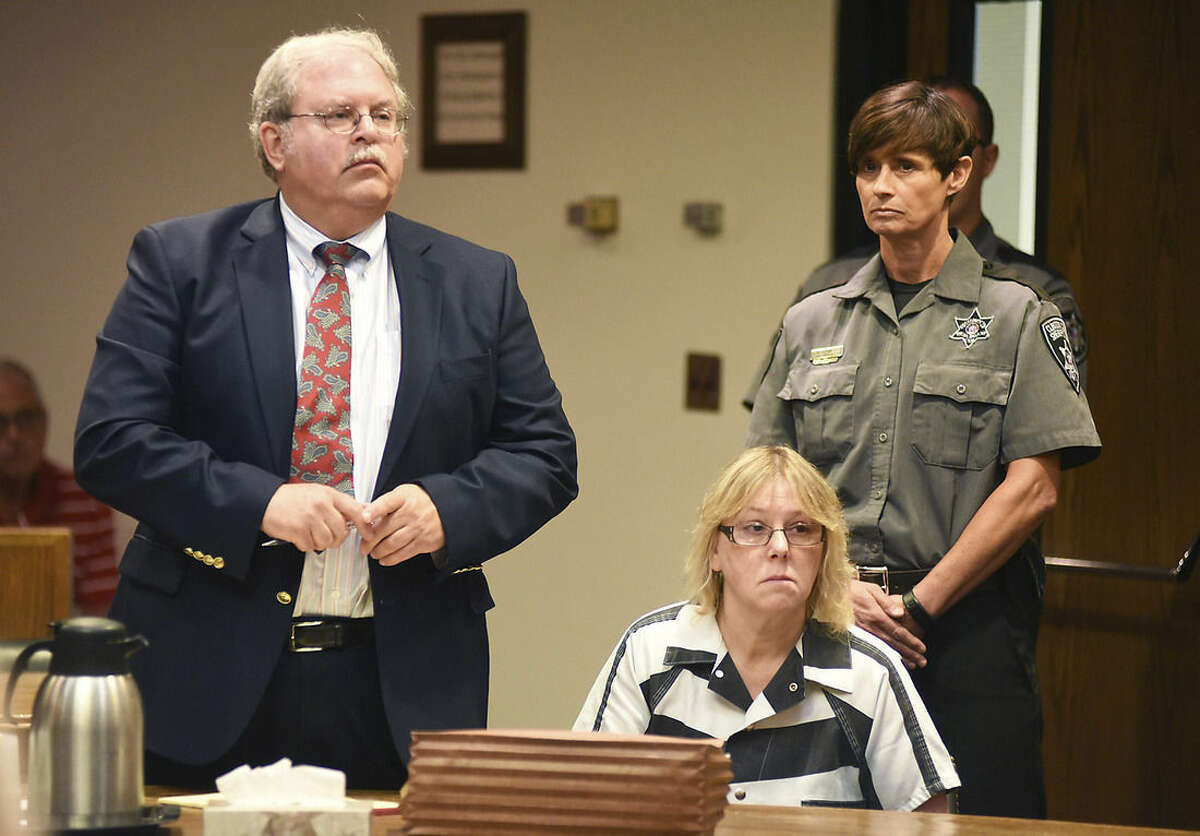 Joyce Mitchell as her attorney Stephen Johnston looks on during a court appearance, Tuesday July 28, 2015 in Plattsburgh, N.Y. Mitchell, an instructor in the tailor shop at the Clinton Correctional Facility, pleaded guilty to charges of aiding two inmates convicted of murder by smuggling hacksaw blades and other tools to the pair, who broke out and spent three weeks on the run in June. She faces a sentence of 2 1/3 to 7 years in prison under terms of a plea deal with prosecutors. (Rob Fountain/The Press-Republican via AP, Pool)