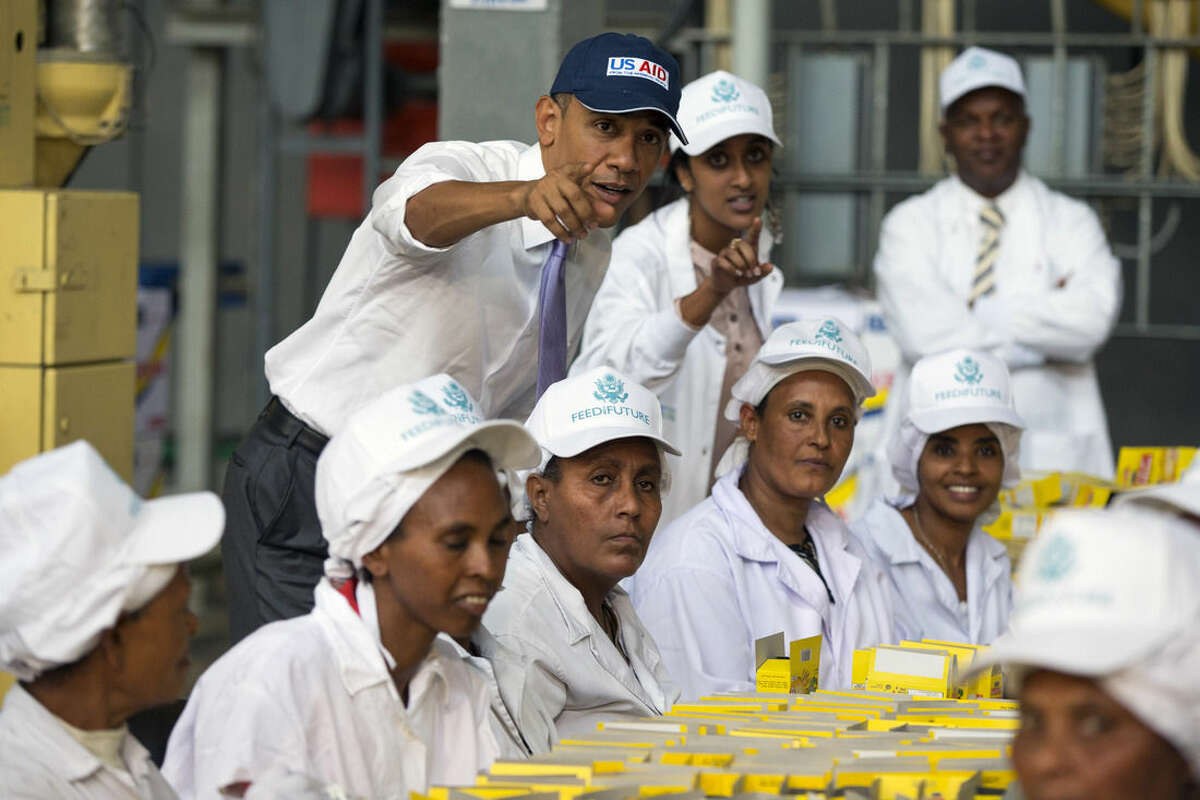 U.S. President Barack Obama talks with workers during a tour of Faffa Food, Tuesday, July 28, 2015, in Addis Ababa, Ethiopia. On the final day of his African trip, Obama is focusing on economic opportunities and African security. (AP Photo/Evan Vucci)