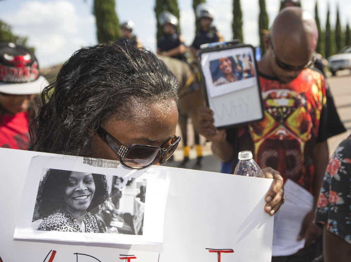 Margaret Hilaire bows her head in prayer during a demonstration calling for the firing and indictment of Texas State Trooper Brian Encinia, Sunday, July 26, 2015, in Katy, Texas. Sandra Bland was found dead in her cell on July 13 in the Waller County Jail, just days after being arrested by Encinia during a traffic stop. Authorities determined through an autopsy that Bland hanged herself with a plastic bag. (Brett Coomer/Houston Chronicle via AP)