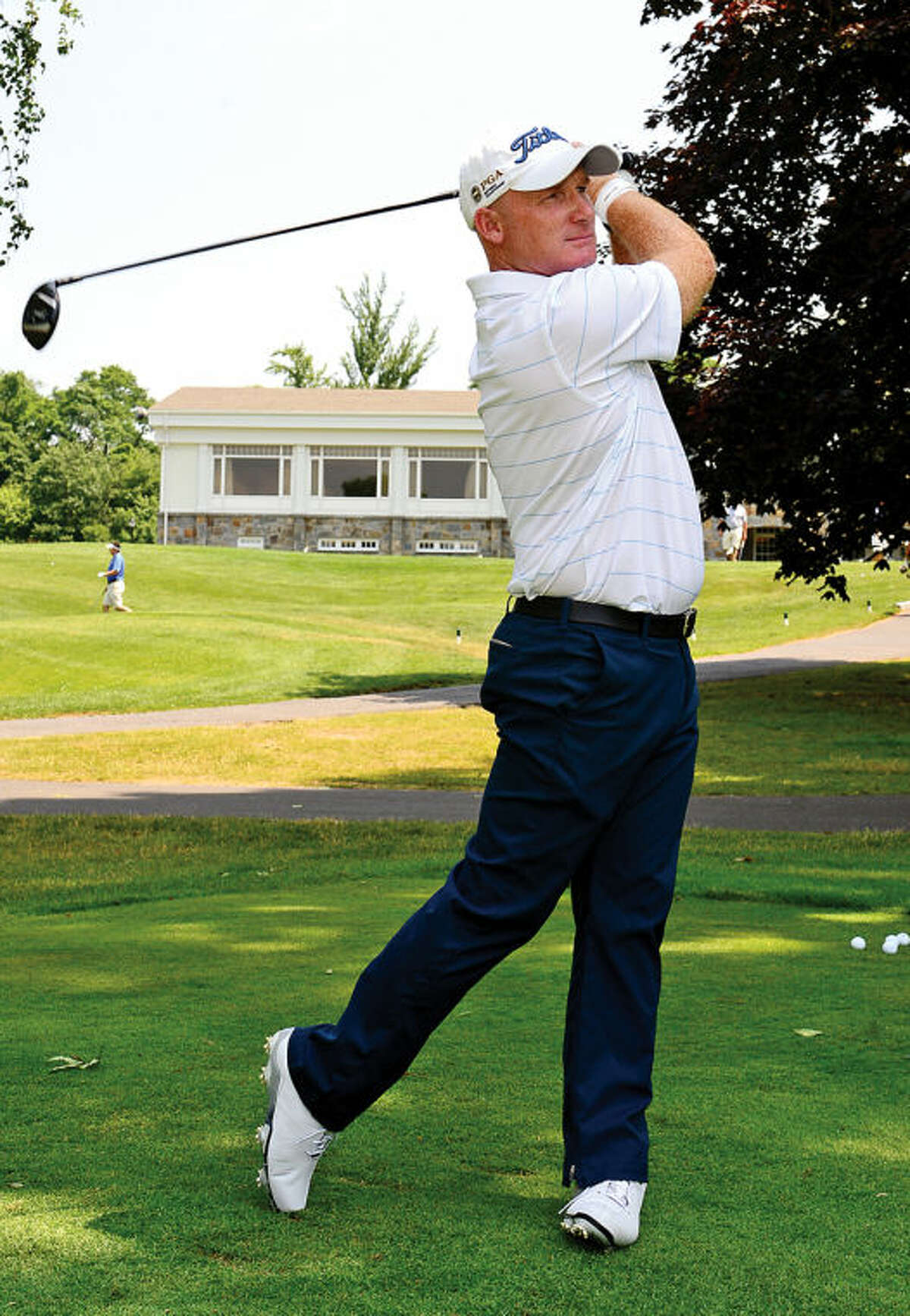 Hour photo / Erik Trautmann Former Norwalk resident and golf pro Frank Bensel tees off at Rolling Hills Country Club following a press conference/media day announcing the upcoming Connecticut Open Golf Championship at the club Wednesday.