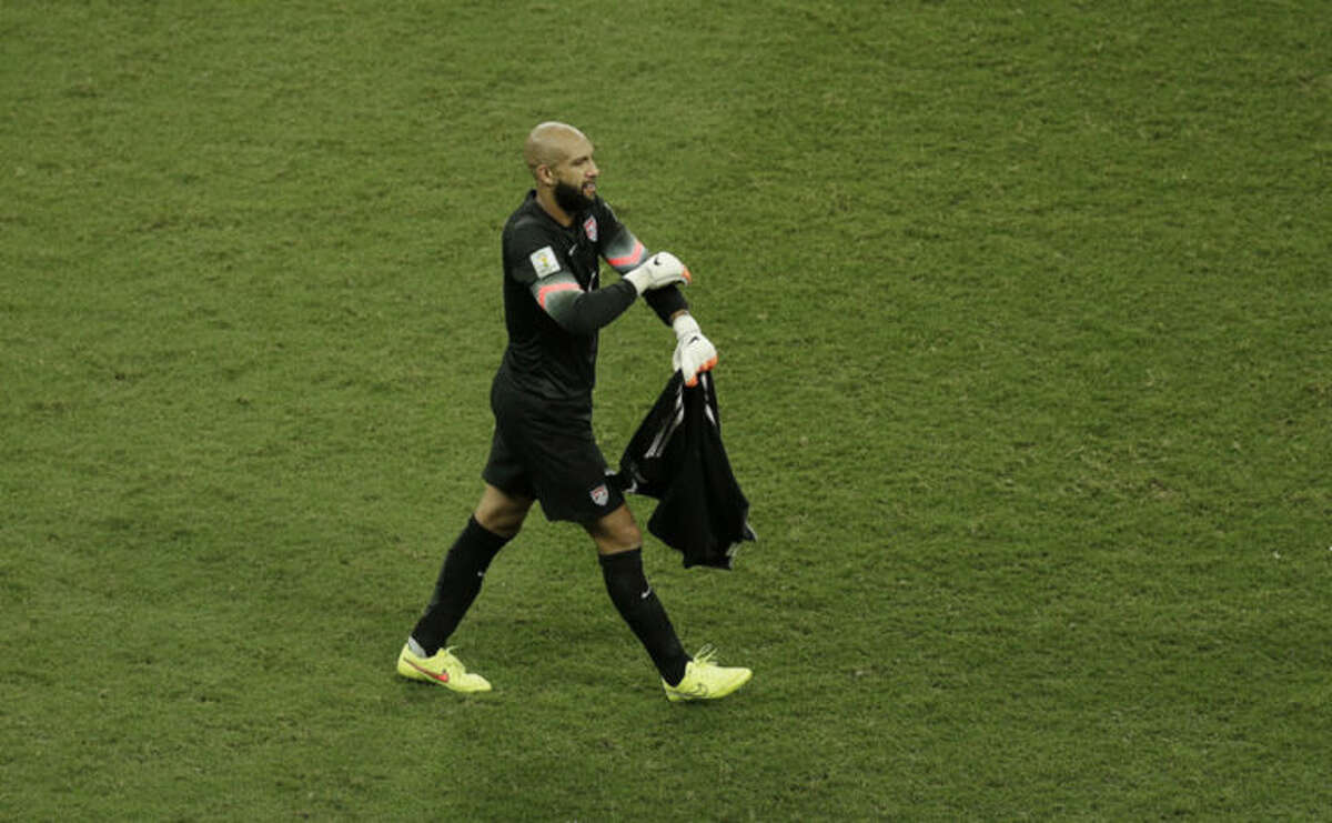 United States' goalkeeper Tim Howard walks over the pitch at the end of the regular playing time during the World Cup round of 16 soccer match between Belgium and the USA at the Arena Fonte Nova in Salvador, Brazil, Tuesday, July 1, 2014. (AP Photo/Themba Hadebe)