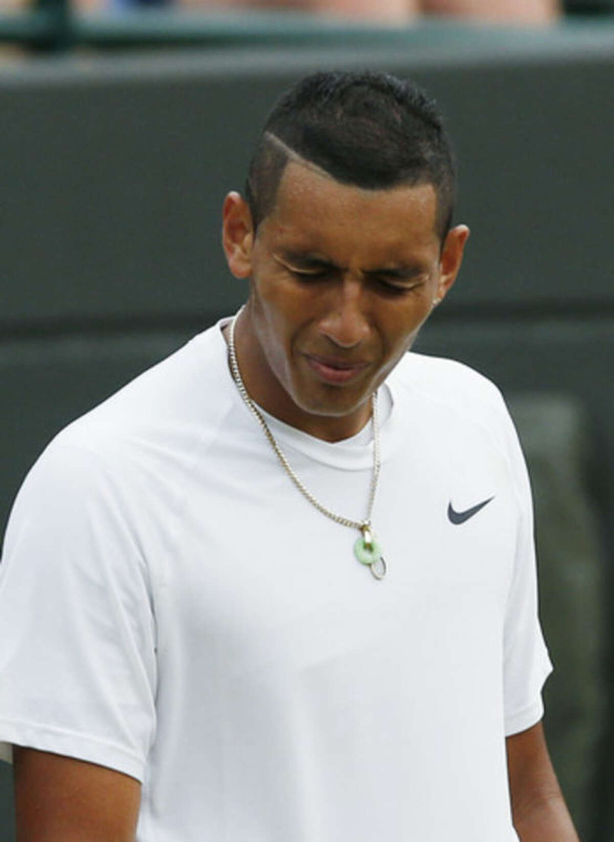 Nick Kyrgios of Australia reacts after losing a point during the men's singles quarterfinal match against Milos Raonic of Canada at the All England Lawn Tennis Championships in Wimbledon, London, Wednesday, July 2, 2014. (AP Photo/Ben Curtis)