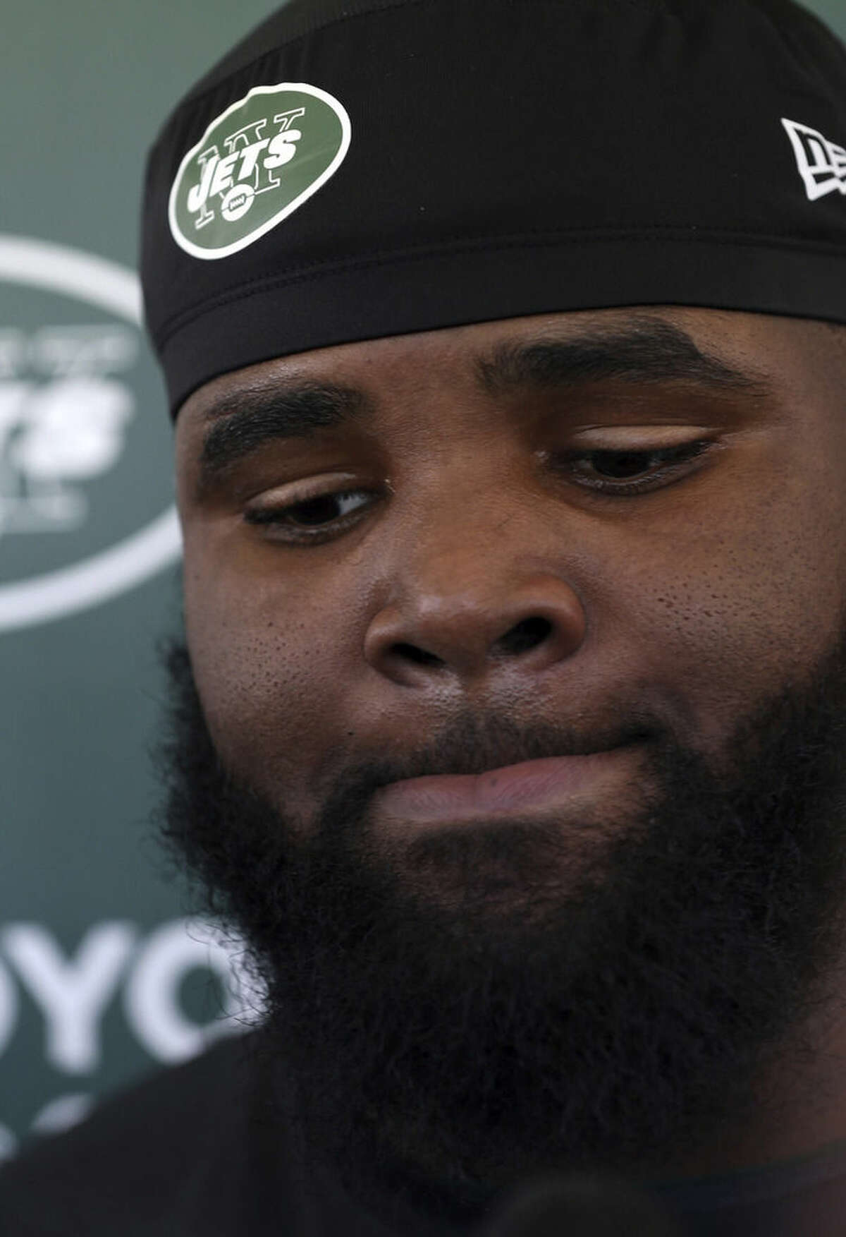 New York Jets defensive end Sheldon Richardson reacts while talking with reporters at NFL football training camp in Florham Park, N.J., Friday, July 31, 2015. (AP Photo/Adam Hunger)