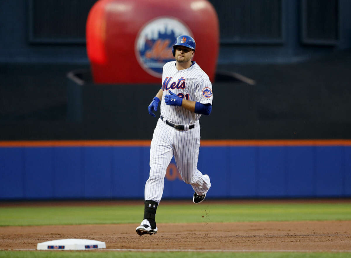 New York Mets Lucas Duda trots past the outfield apple in center field after hitting a first-inning, two-run home run off San Diego Padres starting pitcher James Shields in a baseball game in New York, Tuesday, July 28, 2015. (AP Photo/Kathy Willens)