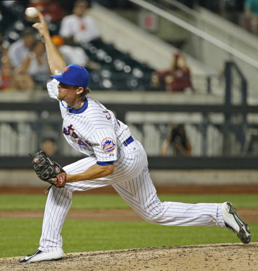 New York Mets newly acquire relief pitcher Tyler Clippard delivers in the ninth inning of the Mets 4-0 shutout victory over the San Diego Padres in a baseball game in New York, Tuesday, July 28, 2015. (AP Photo/Kathy Willens)