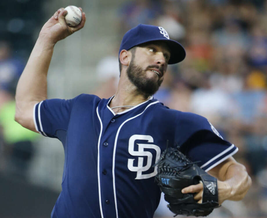 San Diego Padres starting pitcher James Shields delivers in the first inning of a baseball game against the New York Mets in New York, Tuesday, July 28, 2015. (AP Photo/Kathy Willens)