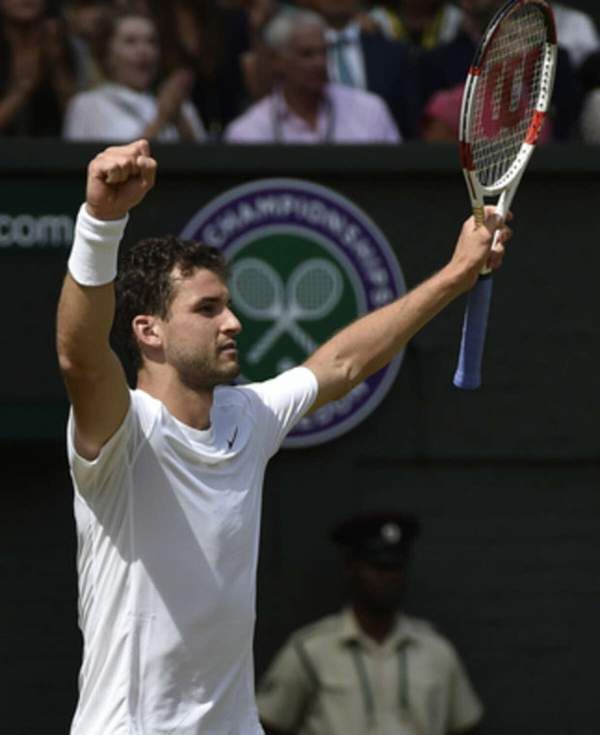 Grigor Dimitrov of Bulgaria celebrates defeating defending champion Andy Murray of Britain in the men's singles quarterfinal match at the All England Lawn Tennis Championships in Wimbledon, London, Wednesday July 2, 2014. (AP Photo/Toby Melville, Pool)