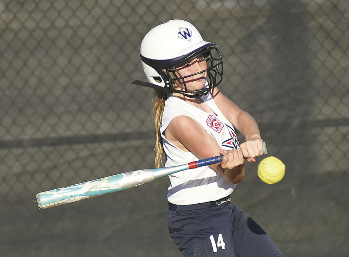 Hour photo/John Nash Westport 10-year-old Little League Softball All-Star Katie Mcgillion-Moore puts the ball into play on a 3-2 count, scoring the go-ahead run in the top of the sixth inning of her team's 2-0 win over Shelton in the Section 1 championship game in Orange.