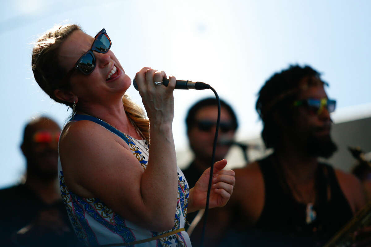 Hour photo/Chris Palermo. Susan Tedeschi sings with Tedeschi Trucks Band during the Gathering of the Vibes festival at Seaside Park in Bridgeport Friday.