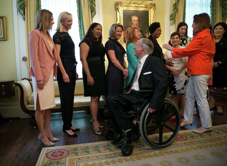 Gov. Greg Abbott and first lady Cecilia Abbott greet members of the Governor's Commission for Women at the mansion. Its operations are supported with state funds of nearly $750,000 a year. Photo: Deborah Cannon /Associated Press / Austin American-Statesman