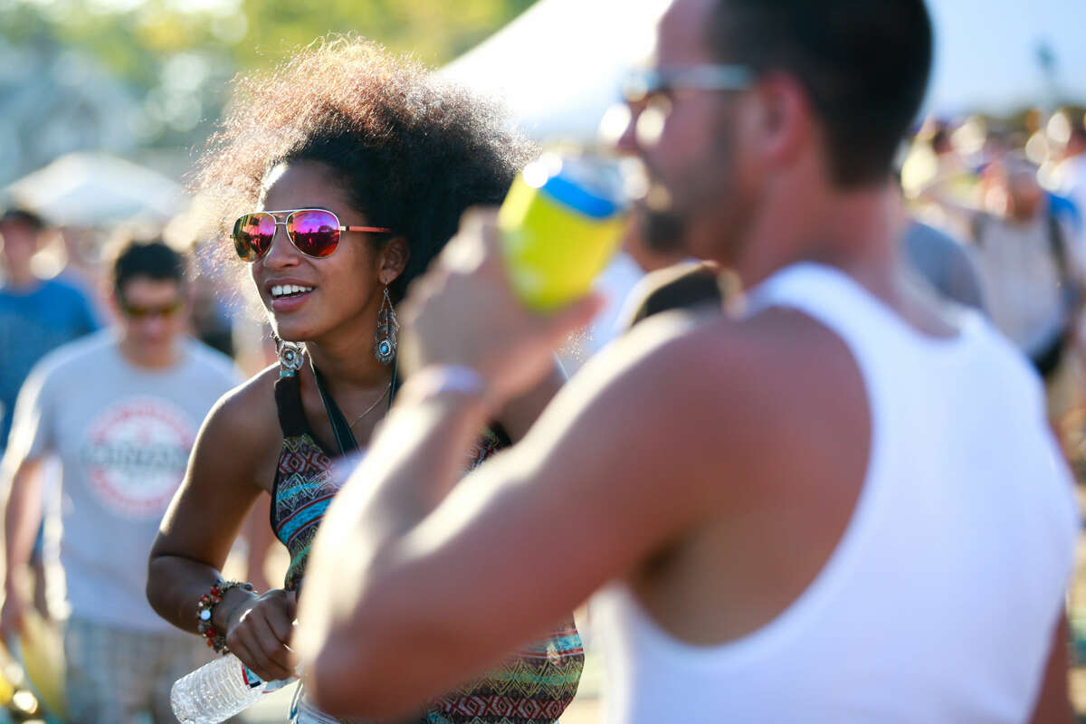 Hour photo/Chris Palermo. Festival goers enjoy the Gathering of the Vibes festival at Seaside Park in Bridgeport Friday.