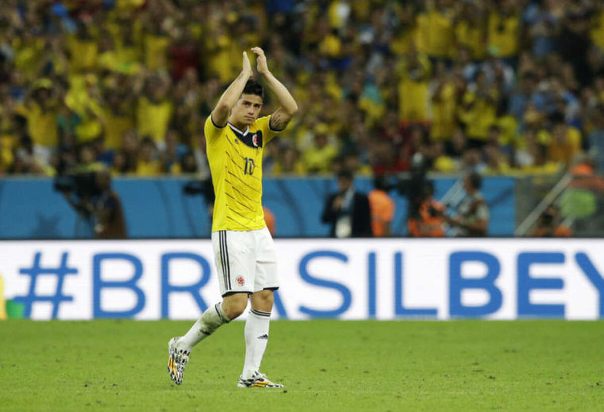 Colombia's James Rodriguez applauds as he replaced after scoring his side's two goals during the World Cup round of 16 soccer match between Colombia and Uruguay at the Maracana Stadium in Rio de Janeiro, Brazil, Saturday, June 28, 2014. (AP Photo/Matt Dunham)