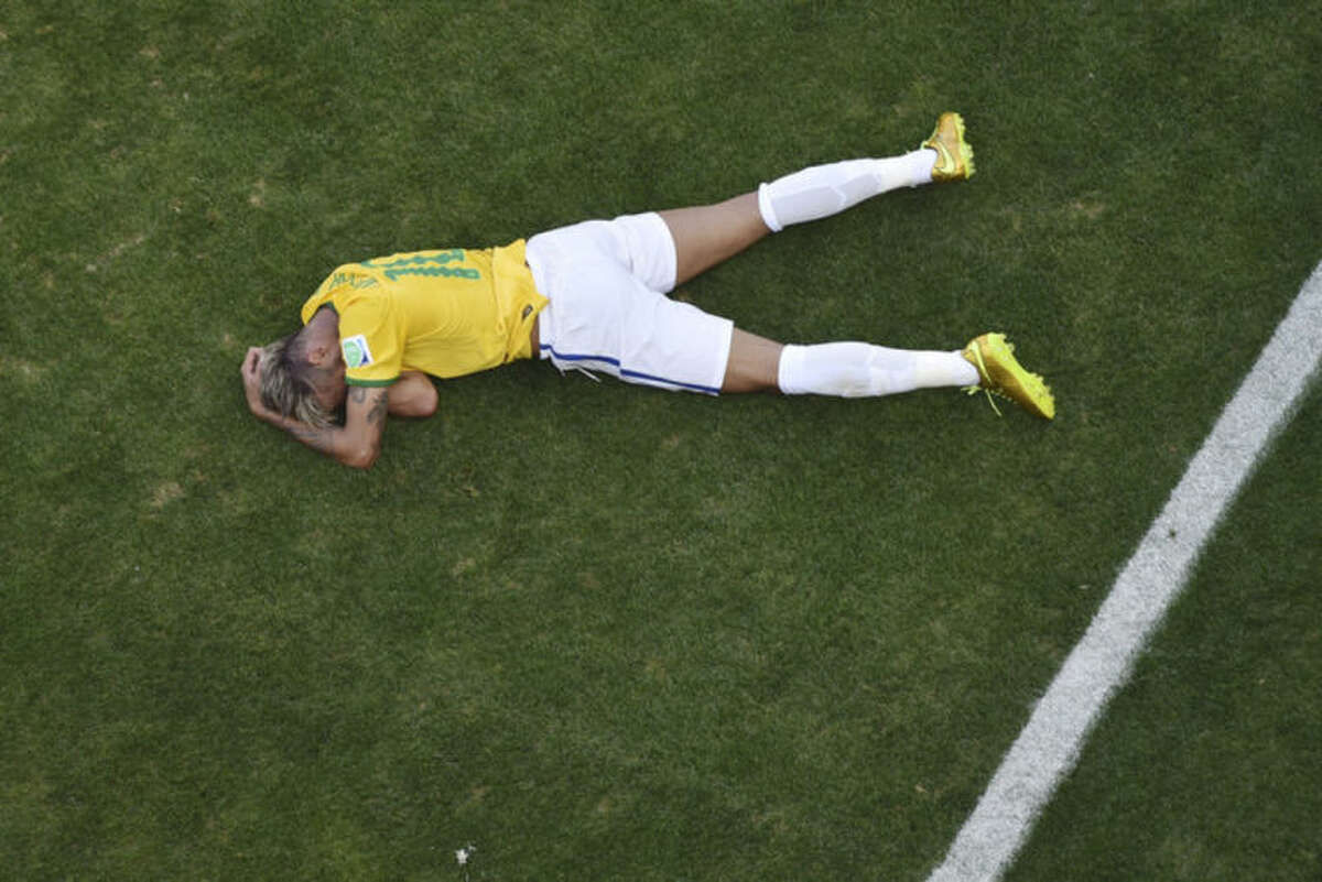 Brazil's Neymar sits on the pitch during the World Cup round of 16 soccer match between Brazil and Chile at the Mineirao Stadium in Belo Horizonte, Brazil, Saturday, June 28, 2014. (AP Photo/Francois Xavier Marit, pool)