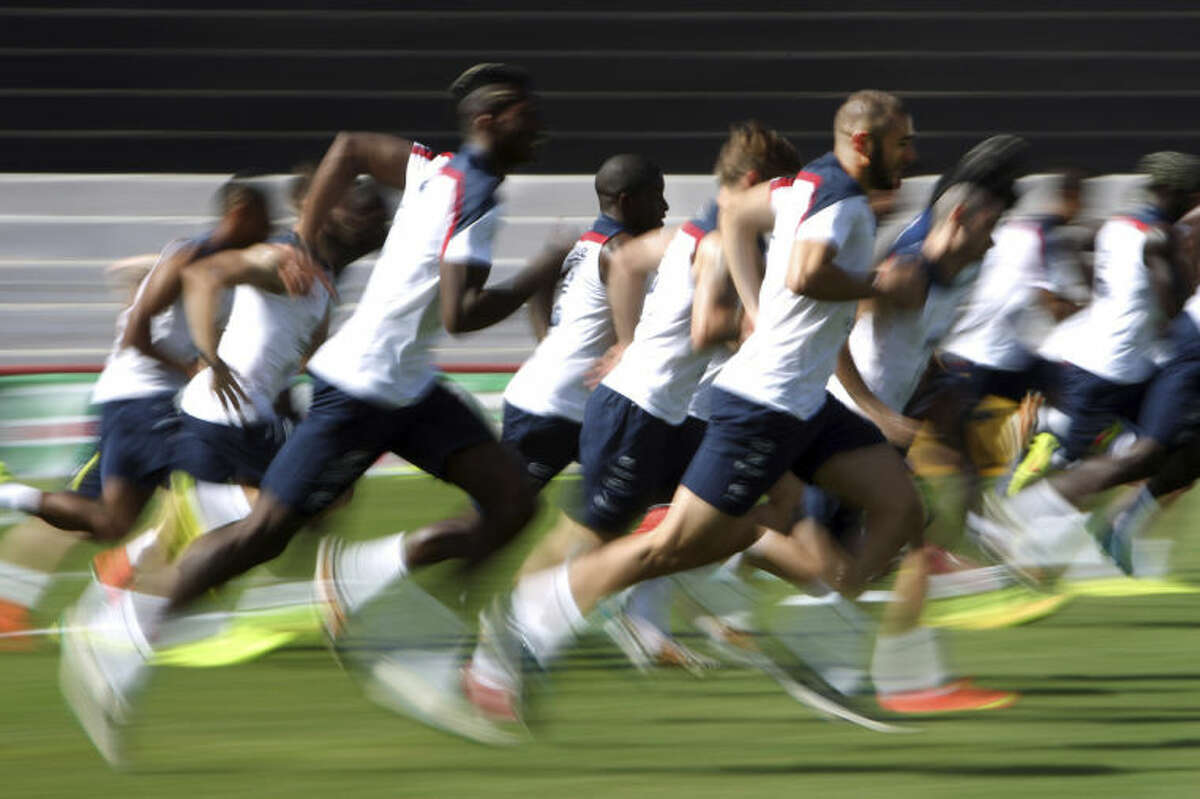 France's national soccer squad sprint during a training session at the Santa Cruz stadium, in Ribeirao Preto, Brazil, Wednesday, July 2, 2014. France will face Germany in their World Cup quarterfinal, Friday. (AP Photo/David Vincent)