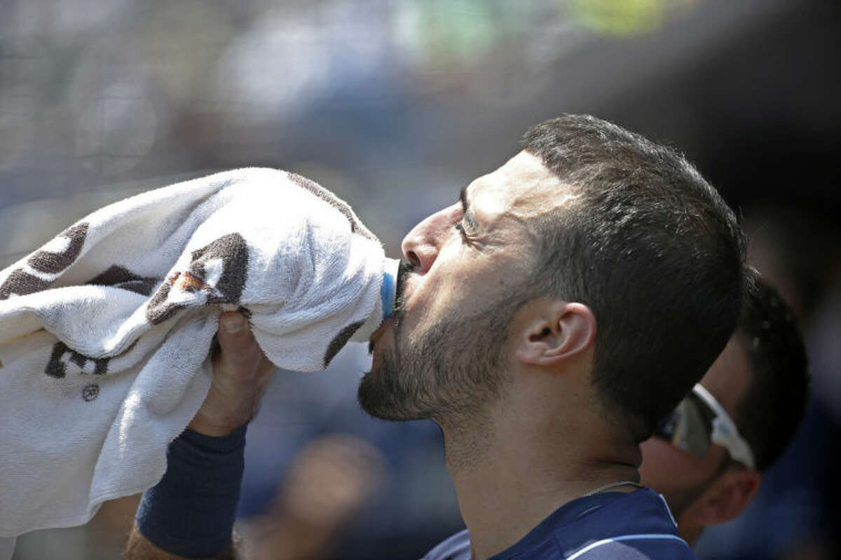 Tampa Bay Rays shortstop Sean Rodriguez drinks a beverage in the dugout before heading out to the infield in a baseball game against the New York Yankees, at Yankee Stadium in New York, Wednesday, July 2, 2014. (AP Photo/Kathy Willens)