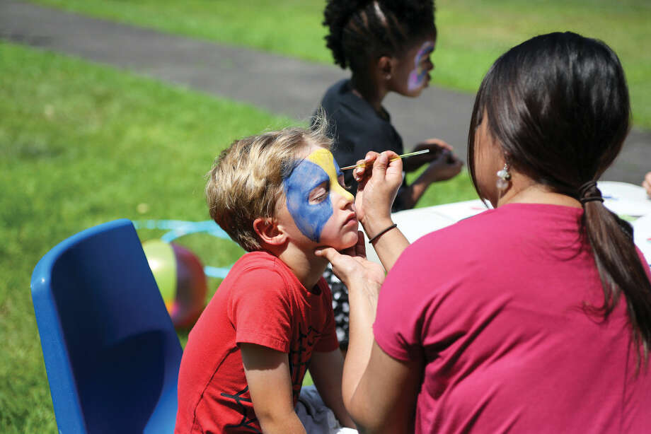 Westley Soreff, 6, gets his face painted during Norwalk's Citywide Summer Reading Challenge-Family Fun Festival at Union Park in Norwalk Saturday morning. Hour Photo / Danielle Calloway