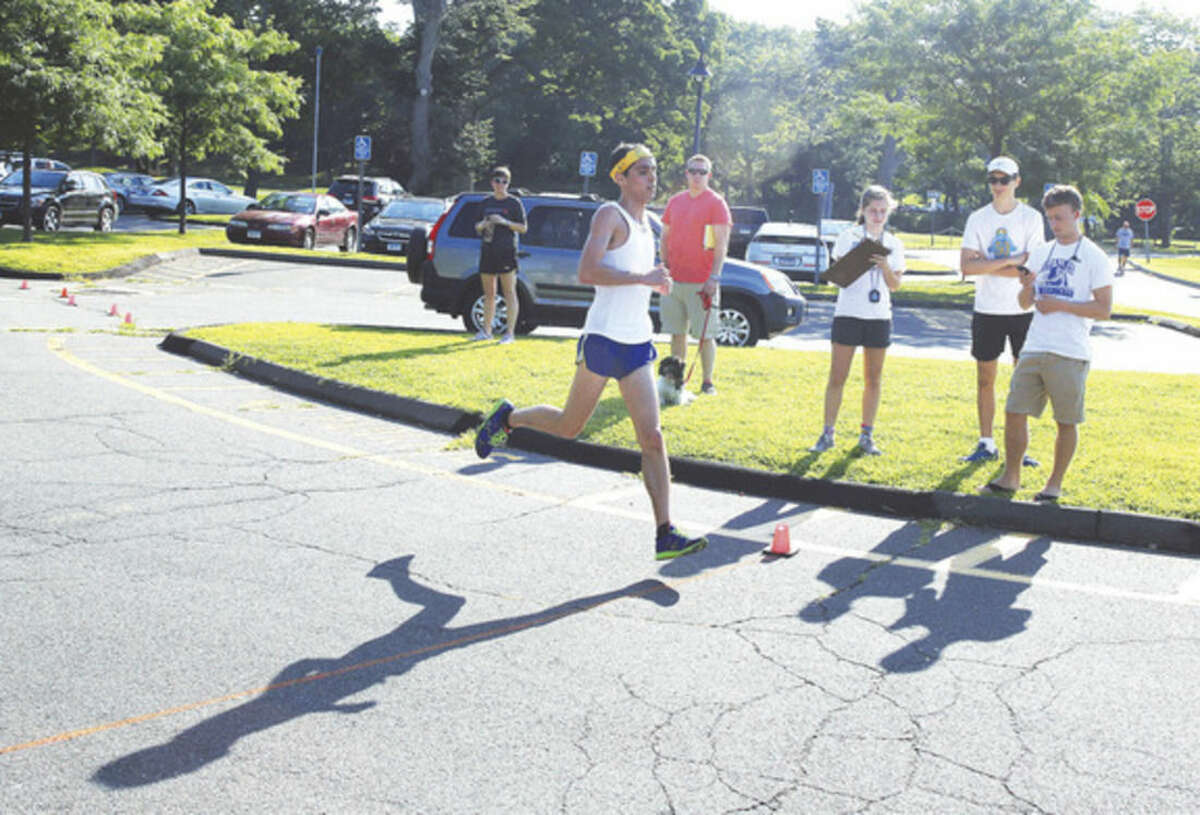 Matt Klein comes in first place during the Westport Road Runners 4.7 mile road race at Longshore Country Club in Westport Saturday morning. Hour Photo / Danielle Calloway