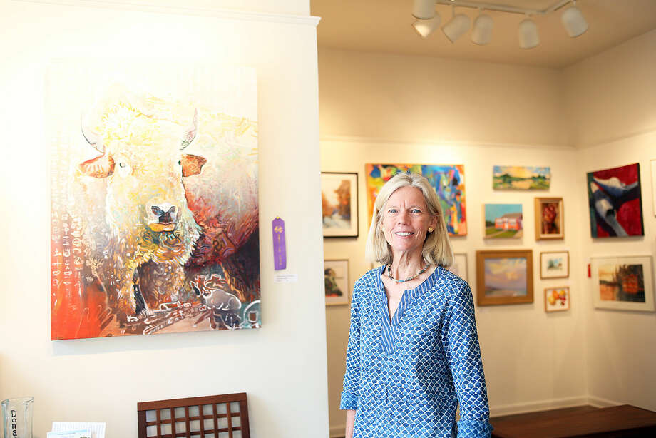"Joanna Bridges, Exhibitions Chair, talks about the Best in Show painting called ""Beauty's White Dust"" by Pilar Joanna Garra, part of the Brushwork 2015 show at the Rowayton Arts Center Saturday morning. Hour Photo / Danielle Calloway"