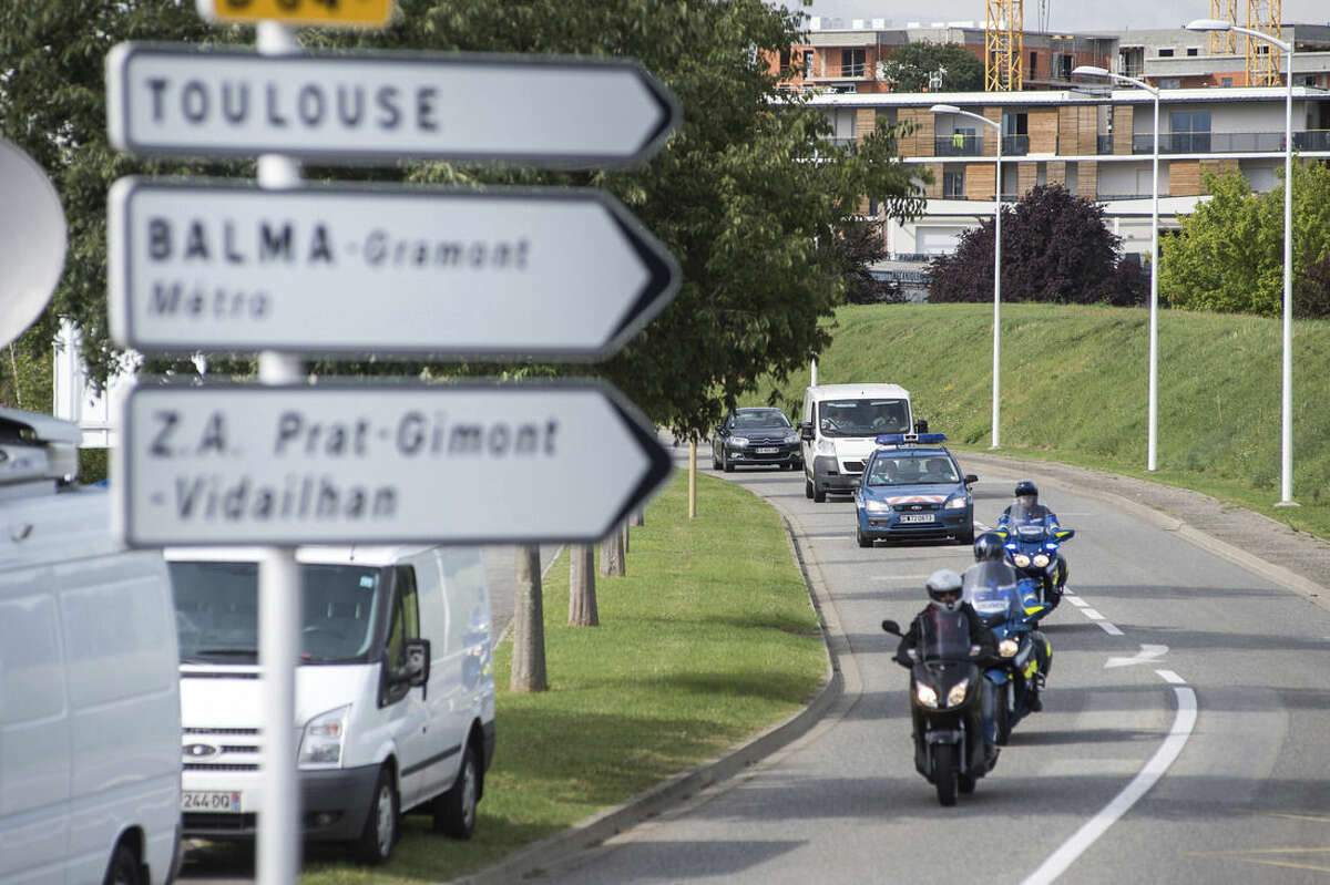 A white van, accompanied by police motorcycles and a police car transporting what is believed to be debris from a Boeing 777 plane that washed up on an Indian Ocean island, on route to Direction Generale de L'armement (DGA) facilities in Blagnac, near Toulouse, south-western France, Saturday, Aug. 1, 2015. A piece of plane wing that could be from missing Malaysia Airlines Flight 370 arrived Saturday in Toulouse, France, for inspection by military aviation experts.The 6-foot-long part, wrapped in a box and shipped as cargo, was flown from the small island of Reunion, near Madagascar. (AP Photo/Fred Lancelot)