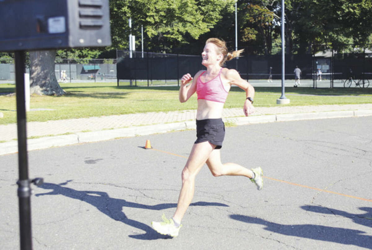 Eliza Tabacchi comes in first place for the women during the Westport Road Runners 4.7 mile road race at Longshore Country Club in Westport Saturday morning. Hour Photo / Danielle Calloway