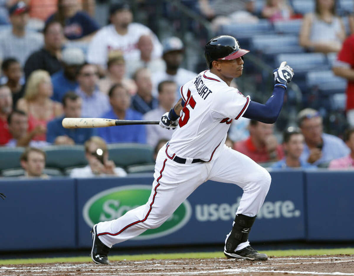 Atlanta Braves' Christian Bethancourt (25) drives in a run with a base hit in the second inning of a baseball game against the New York Mets in Atlanta, Tuesday, July 1, 2014. (AP Photo/John Bazemore)