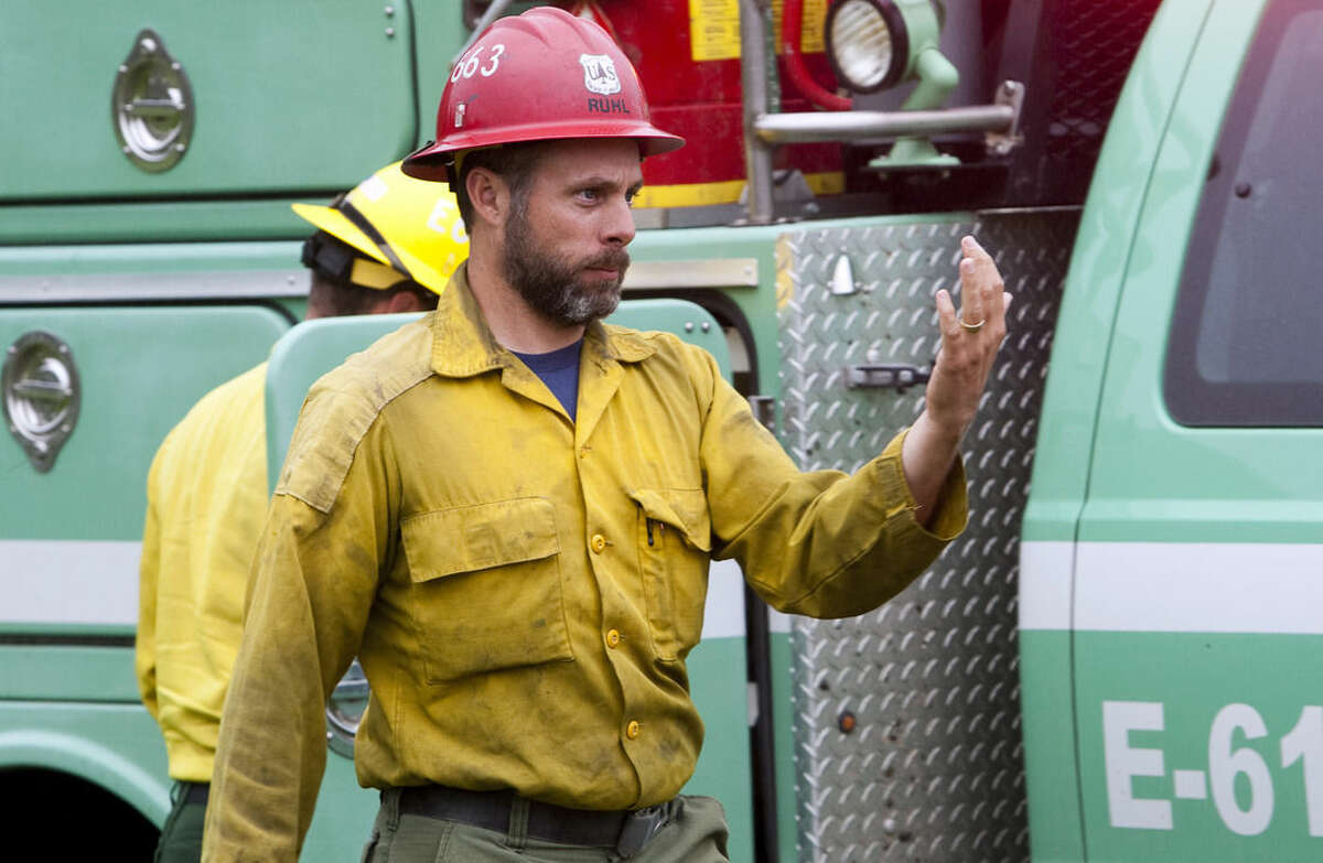 This 2014 photo provided by the Black Hills, S.D., National Forest shows U.S. Forest Service firefighter David Ruhl in the national forest near Custer, S.D. Ruhl, 38, of Rapid City, S.D., was killed while scouting a wildfire in Northern California when he became trapped by the wind-stoked blaze, officials said Saturday, Aug. 1, 2015. (Black Hills National Forest via AP)