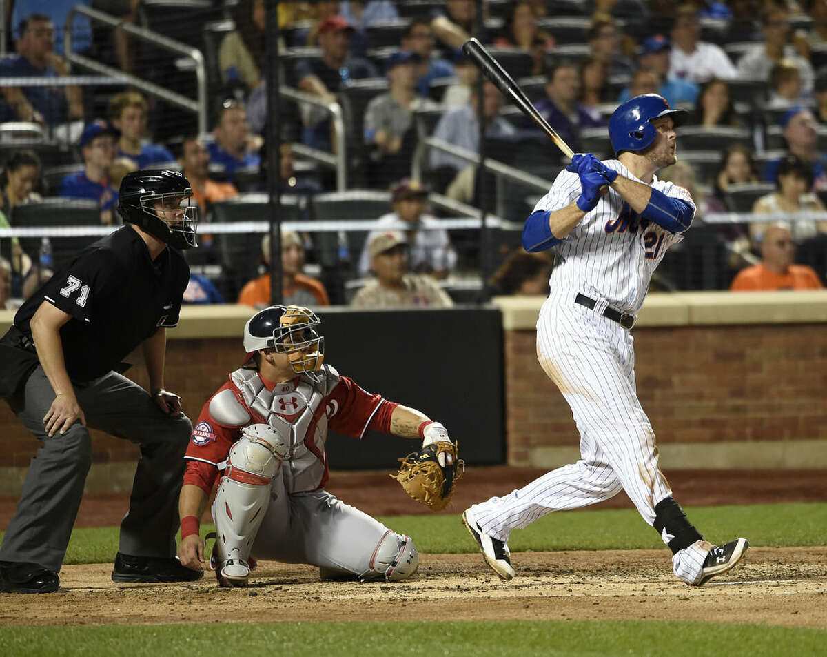 Washington Nationals catcher Wilson Ramos, center, and New York Mets' Lucas Duda, right,watch Duda's solo home run off of Washington Nationals starting pitcher Joe Ross in the fourth inning of a baseball game at Citi Field on Saturday, Aug. 1, 2015, in New York. (AP Photo/Kathy Kmonicek)