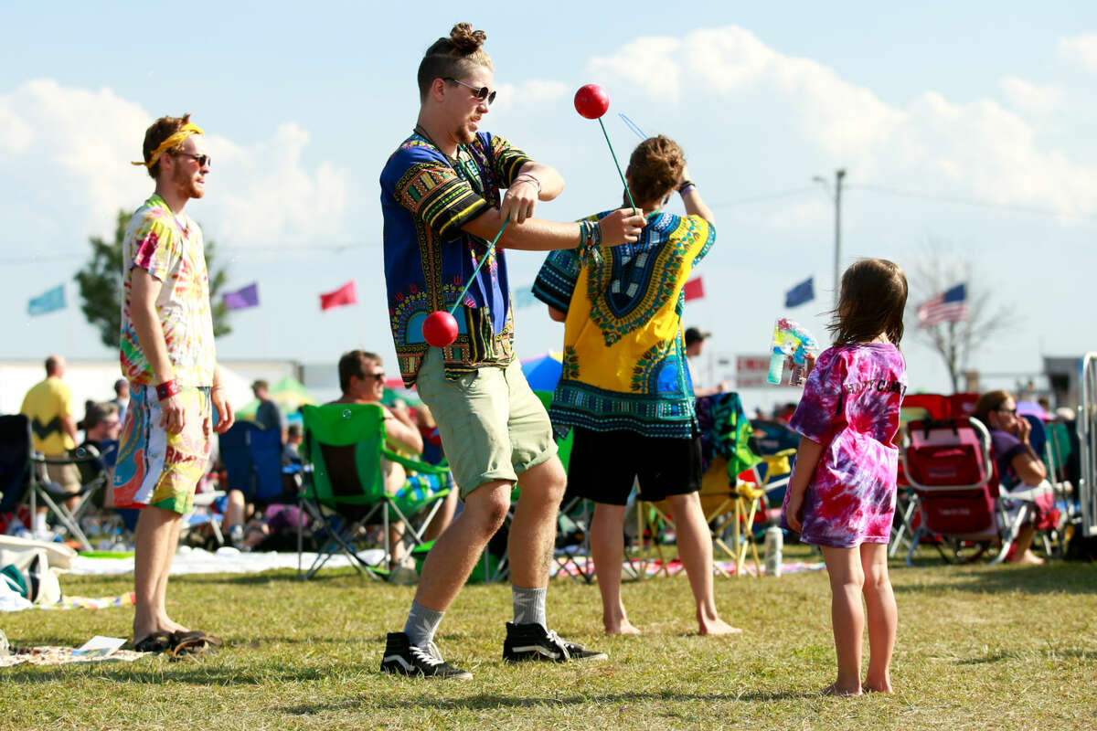 Hour photo/Chris Palermo. Festival goers enjoy the Gathering of the Vibes festival at Seaside Park in Bridgeport Saturday.