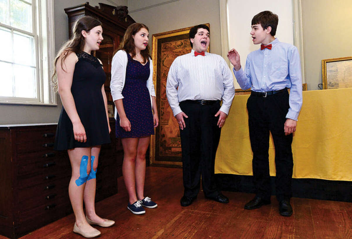 Hour photo / Erik Trautmann Members of the Crystal Theater, Elizabeth Marco, Krystina Lyons, Max Helfand and Kyle Breen sing the national anthem during The Norwalk Historical Society Independance Day
