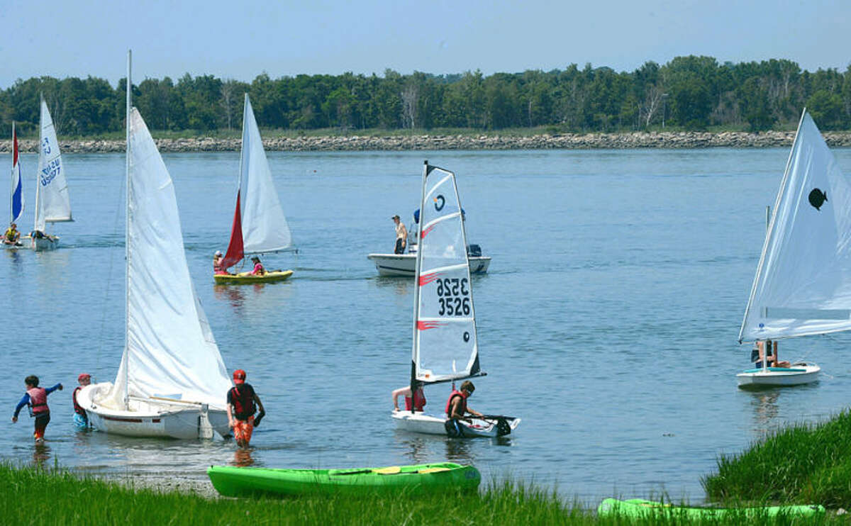 Hour photo / Erik Trautmann Campers with the Norwalk Sailing School set out into Long Island Sound on a steamy Tuesday.