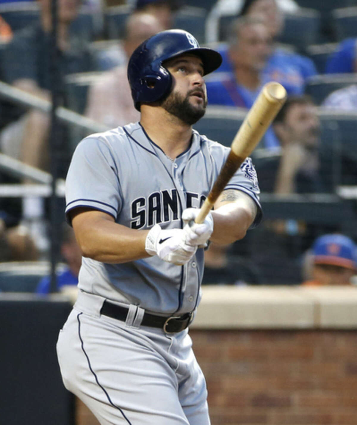 San Diego Padres' Yonder Alonso watches his third-inning solo home run off New York Mets starting pitcher Bartolo Colon in a baseball game in New York, Wednesday, July 29, 2015. (AP Photo/Kathy Willens)