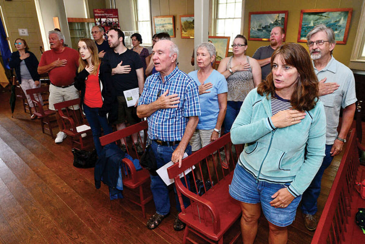 Hour photo / Erik Trautmann Visitors recite the Pledge of Allegiance during The Norwalk Historical Society Independance Day