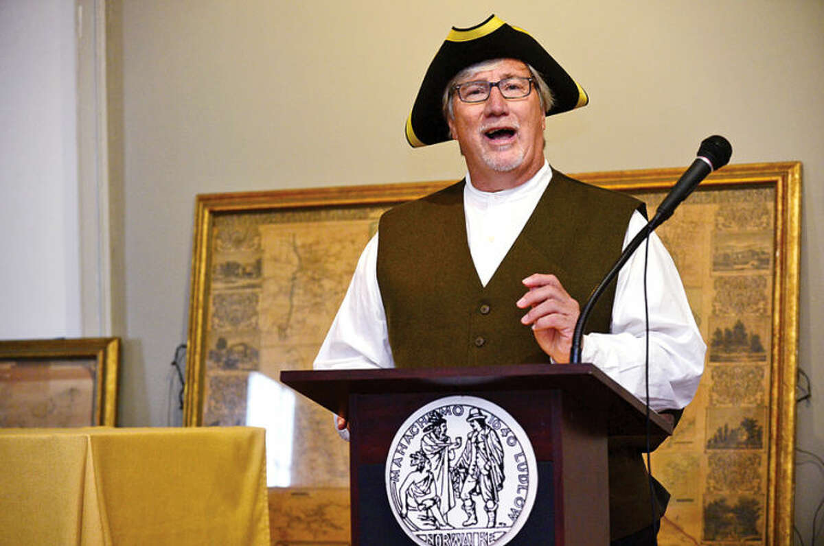 Hour photo / Erik Trautmann Rick McQuaid, City of Norwalk Town Clerk reads the Declaration of Independance while portraying Revolutionary War Town Clerk Samuel Grumman during The Norwalk Historical Society