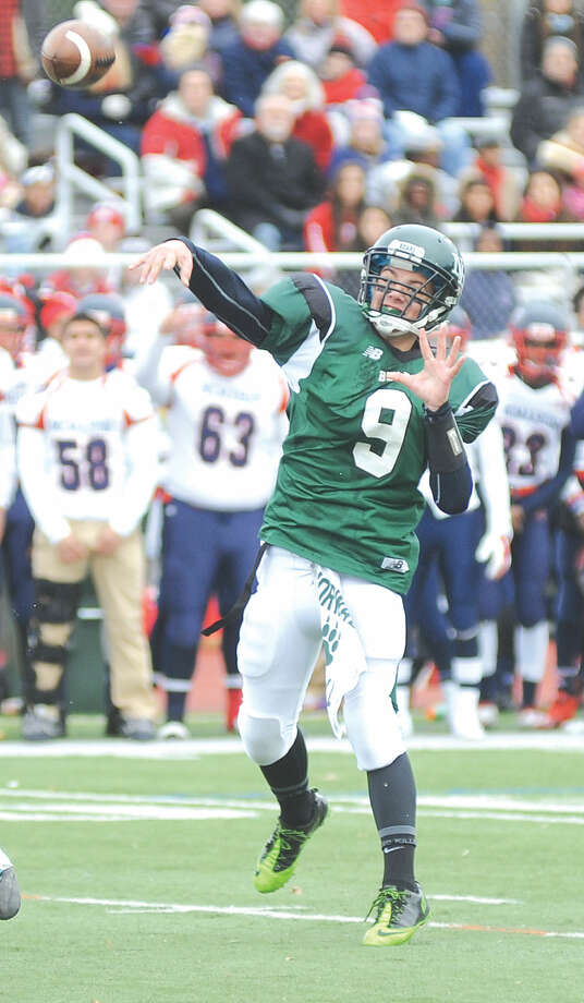 Hour photo/John Nash - Former Norwalk quarterback Greg Goldstein, seen here firing a pass during the Bears' 33-22 win over Brien McMahon in their annual Thanksgiving Day football game, has transferred to St. Luke's School in New Canaan.