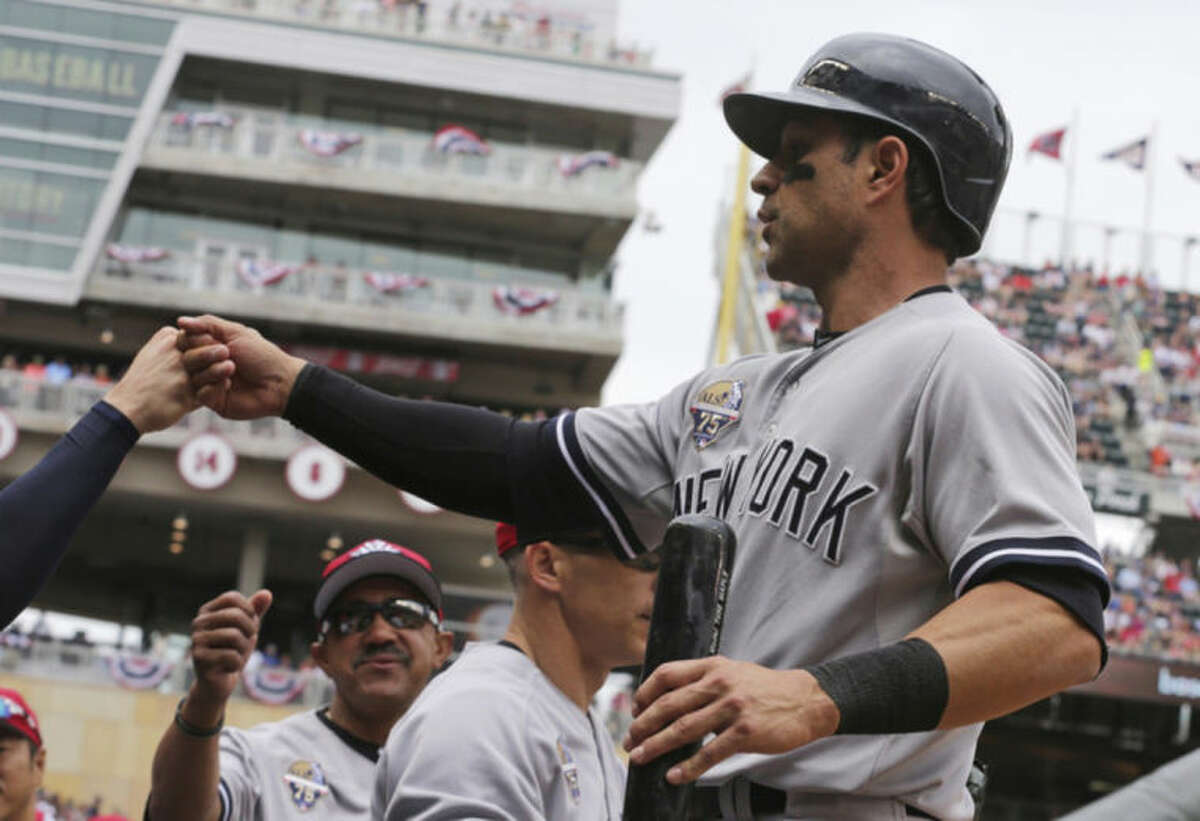 New York Yankees' Brian Roberts scores on a double by Mark Teixeira off Minnesota Twins pitcher Kyle Gibson in the first inning of a baseball game, Friday, July 4, 2014, in Minneapolis. (AP Photo/Jim Mone)