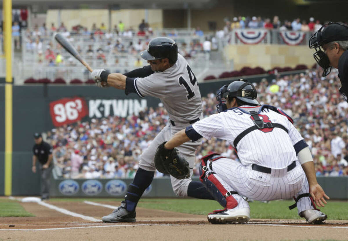 New York Yankees' Brian Roberts hits an RBI-double in the first inning of a baseball game against the Minnesota Twins, Friday, July 4, 2014, in Minneapolis. The Yankees won 6-5. (AP Photo/Jim Mone)