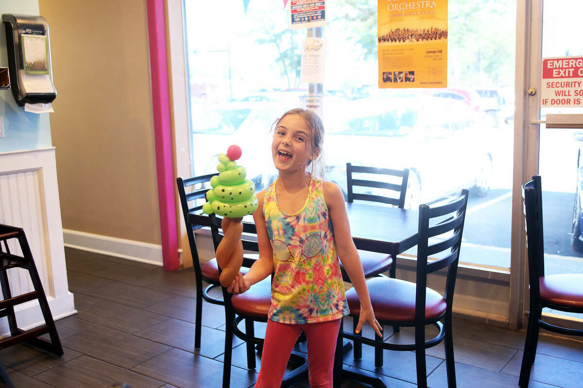 Ellie Anderson, 6, shows off her balloon ice cream cone Balloons By Anthony during Balloon Night at The Dairy Inn on Hope Street.