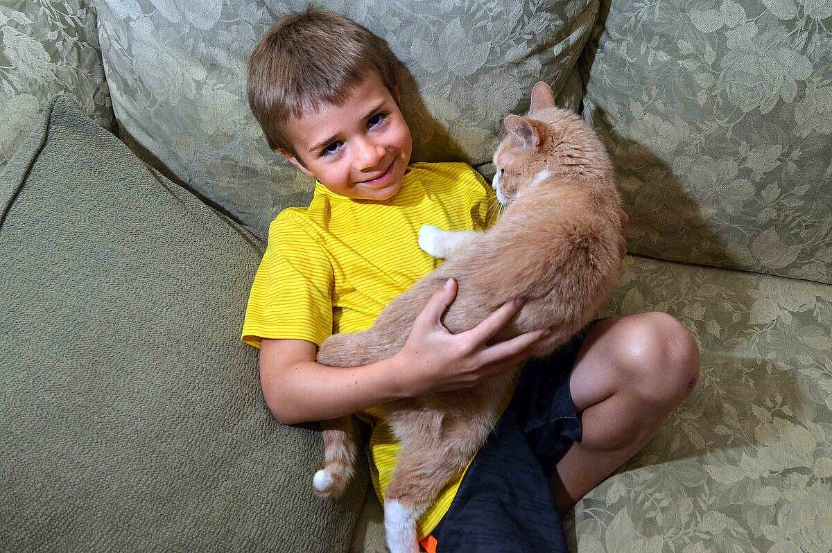 Christopher Ferrante, 7, with the family cat, Rudy.