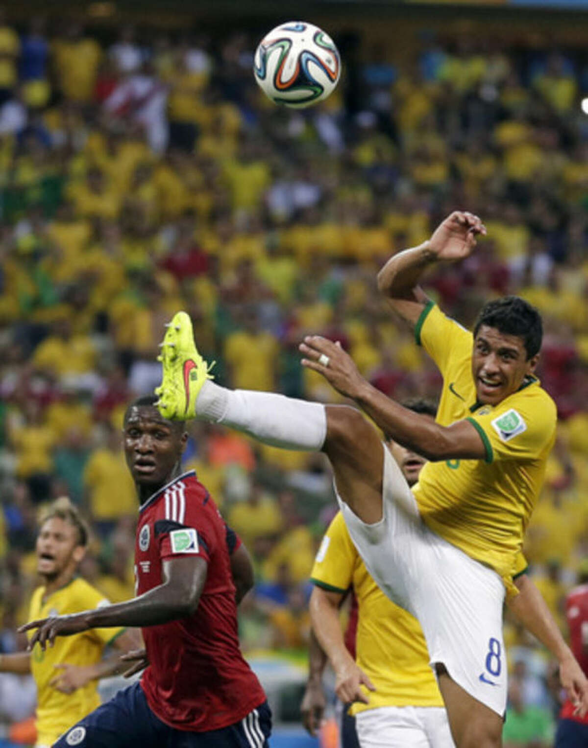Brazil, Germany advance to World Cup semis