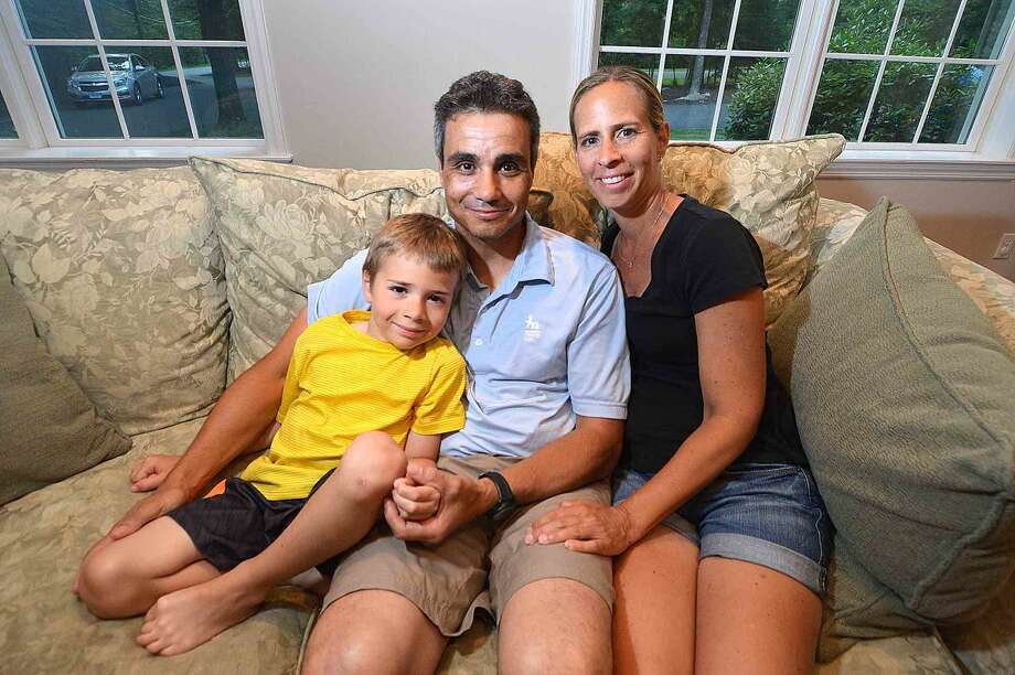 Mario and Andrea Ferrante sit for a photo with their 7-year-old son Christopher, who has undergone numerous surgeries for his scoliosis and kyphosis, and will soon undergo a new spinal lengthening treatment known as MAGEC.