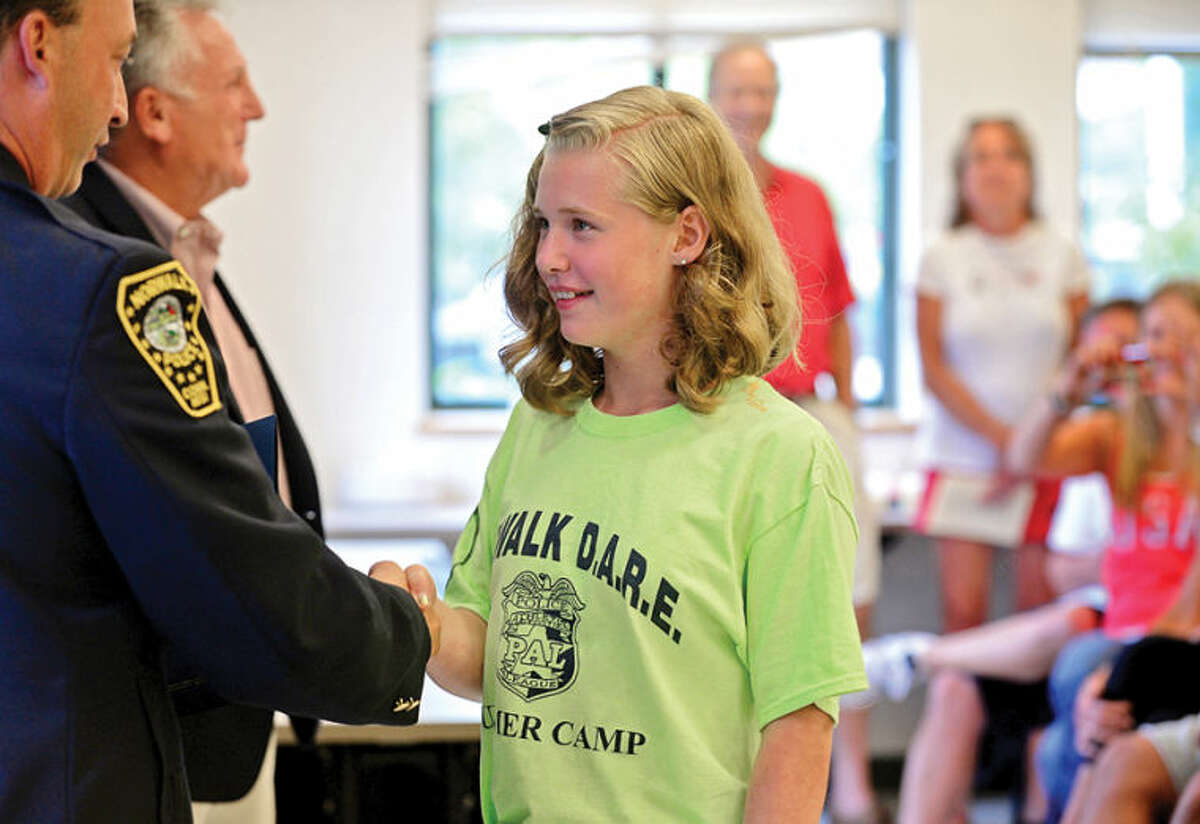 Hour photo / Erik Trautmann Children in the DAREcamp mark their final day of camp with a graduation at the police headquarters Friday.