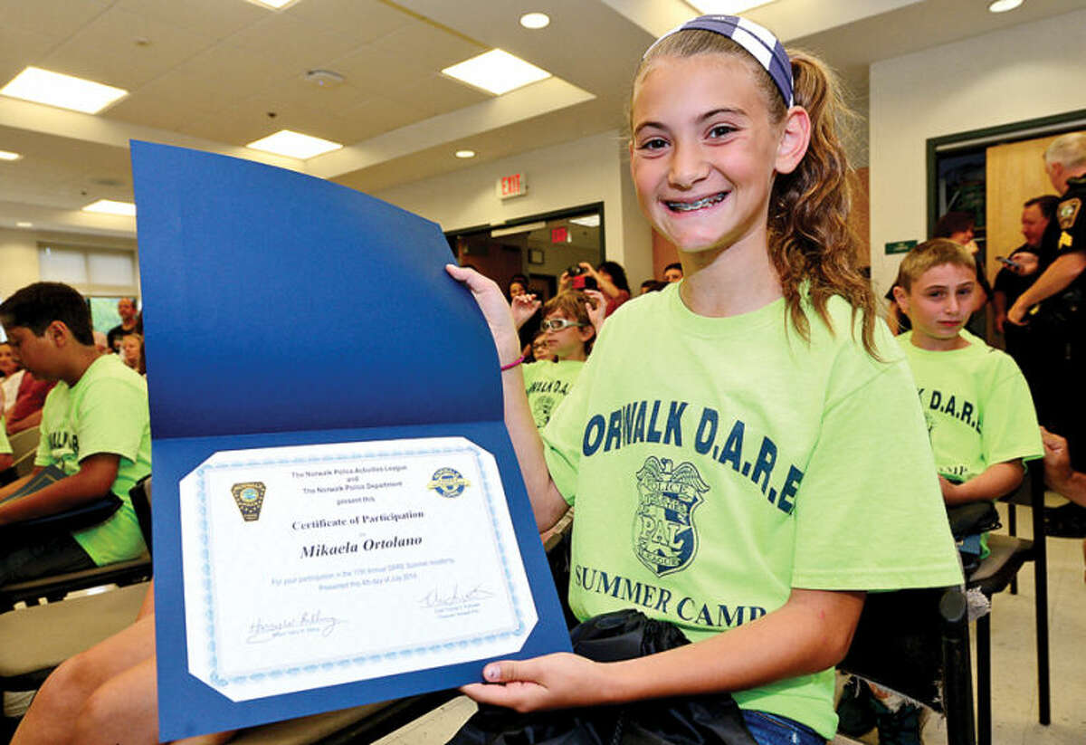 Hour photo / Erik Trautmann Children in the DAREcamp including Mikaela Ortolano mark their final day of camp with a graduation at the police headquarters Friday.